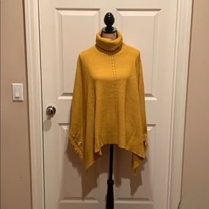 Mustard yellow sweater shawl with side buttons.